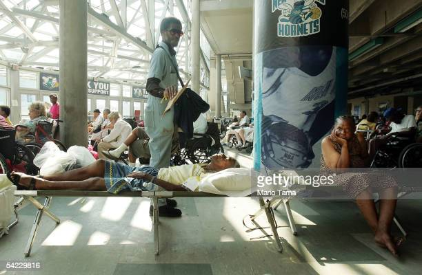 Stranded victims of Hurricane Katrina wait in a building outside the Superdome to be evacuated September 2 2005 in New Orleans Louisiana Thousands of...