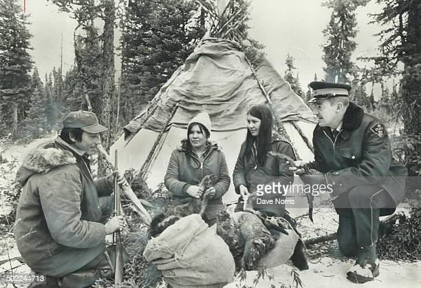 Stranded while trapping along Hudson Bay where shrub trees give way to open tundra the Chookomilin Indian familyAlbert his wife Helen and his sister...