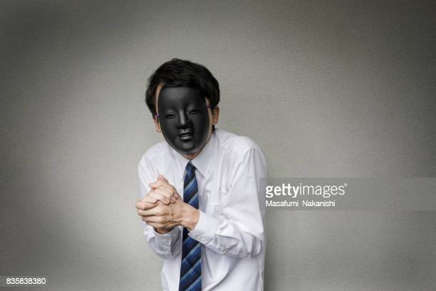 奇妙な仮面の実業家 - セールストーク ストックフォトと画像
