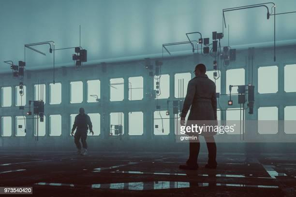 Strange men standing in futuristic building