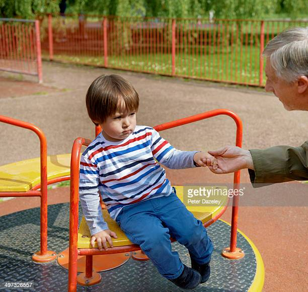 Stranger enticing child off ride in playground