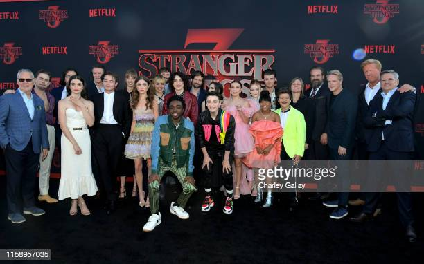 Stranger Things cast and crew pose with Netflix execs at the Stranger Things Season 3 World Premiere on June 28 2019 in Santa Monica California