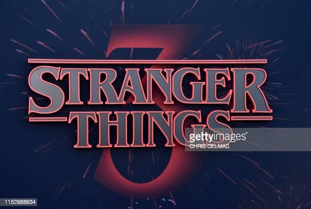"Stranger Things logo seen on the backdrop of Netflix's ""Stranger Things 3"" premiere at Santa Monica high school Barnum Hall on June 28, 2019 in Santa..."