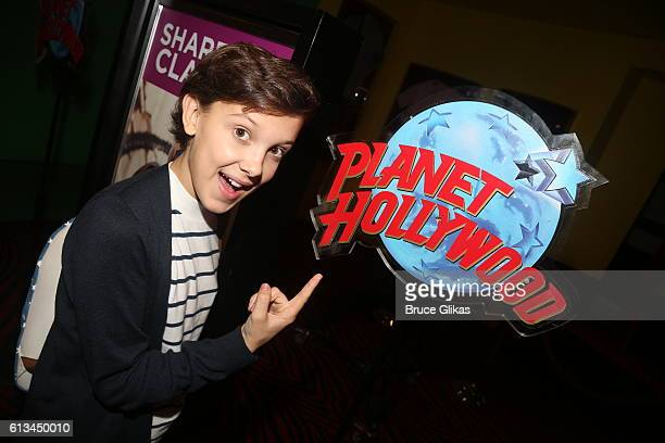 'Stranger Things' star Millie Bobby Brown poses as she visits Planet Hollywood Times Square on October 8 2016 in New York City