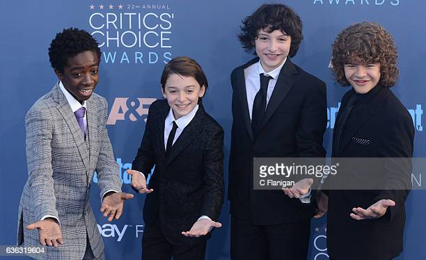 'Stranger Things' stars Caleb McLaughlin Noah Schnapp Finn Wolfhard and Gaten Matarazzo arrive at the The 22nd Annual Critics' Choice Awards at...