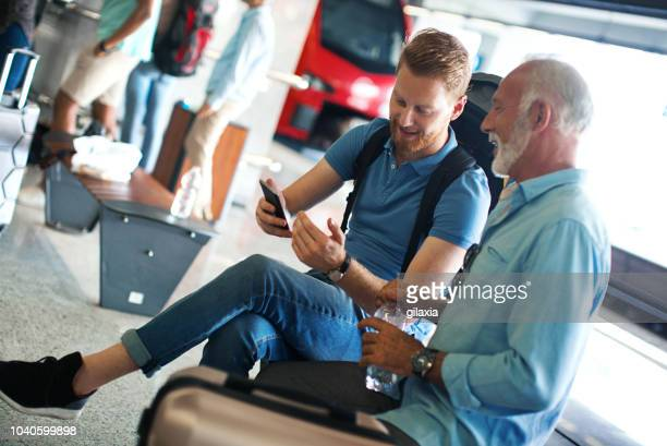 strangers at a train station. - stranger stock pictures, royalty-free photos & images