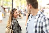 Strangers girl and guy flirting on the street