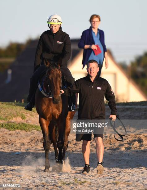 Strapper Umut Odemislioglu walks Ben Cadden riding Winxou to the water at Altona Beach during a recovery session on October 29 2017 in Melbourne...