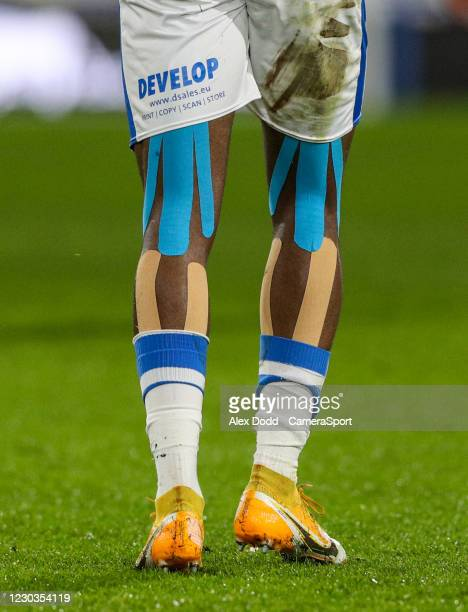 Strapping on the legs of Huddersfield Town's Isaac Mbenza during the Sky Bet Championship match between Huddersfield Town and Blackburn Rovers at...