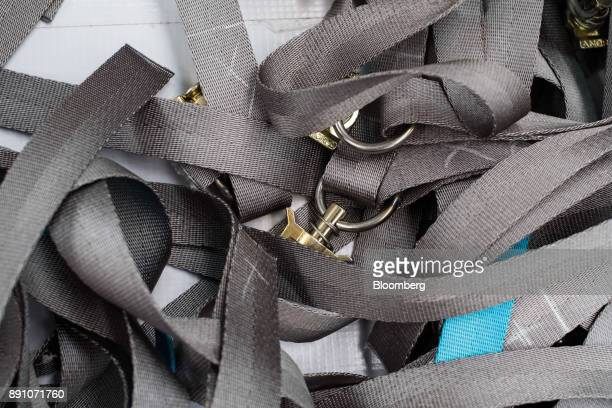 Straps used to assemble aircraft cargo nets sit in a pile at the Tighitco Inc manufacturing facility in San Luis Potosi Mexico on Thursday Nov 16...