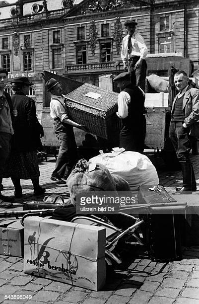 Strasbourg Alsace in 2 WW under German occupation After the entry of German troops into the town return of the inhabitants Unloading luggage from a...
