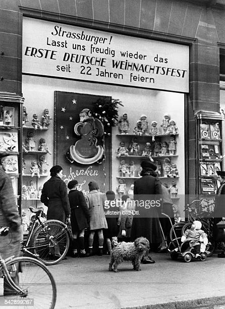 Strasbourg Alsace in 2 WW under german occupation Shopwindow of a toys shop at christmas tide text reads 'Strasbourgers let us joyfully celebrate...