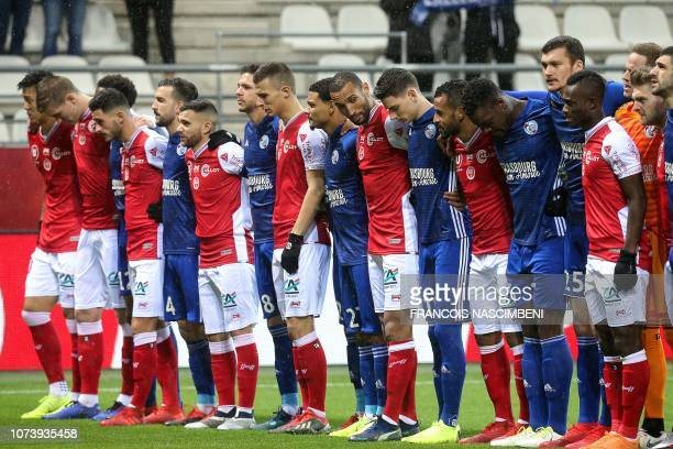 Strasbourg and Reims players observe a minute of silence for the victims of the attack near the Christmas market of Strasbourg on December 11 during...