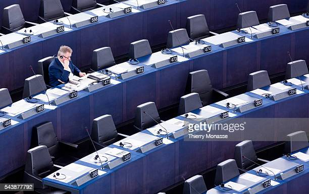 Strasbourg BasRhin France December 16 2104 German member of the European Parliament Jens GEIER is looking at papers during a session of the European...