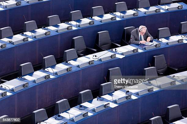 Strasbourg BasRhin France December 16 2104 Spanish Member of the European Parliament Ernest MARAGALL is looking at his phone during a session of the...