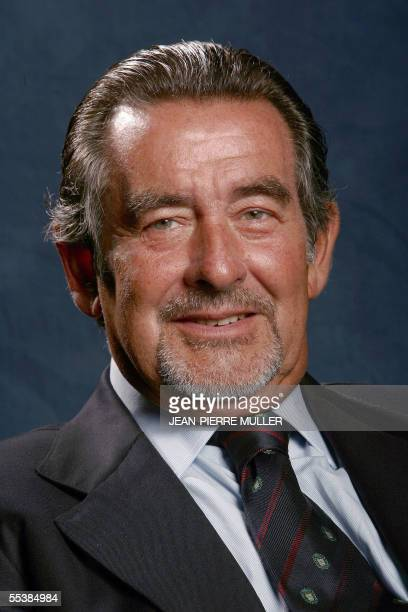 Portuguese eurodeputy and member of the Group of the European People's Party and European Democrats Joao de Deus Pinheiro poses on the sideline of a...