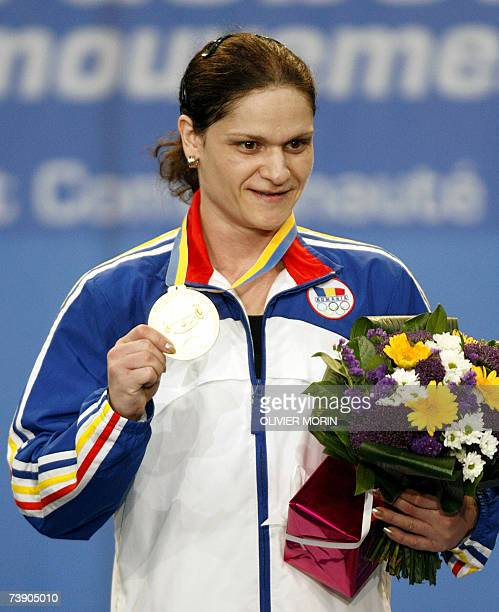 Romanian Marioara Munteanu poses with her gold medal after she won the European Weightlifting championship in the category 53 kg 17 April 2007 in...
