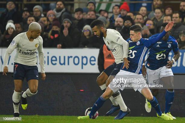 Strasbourg'd French midfielder Anthony Caci vies for the ball with Paris SaintGermain's Cameroonian forward Eric ChoupoMoting and Paris...
