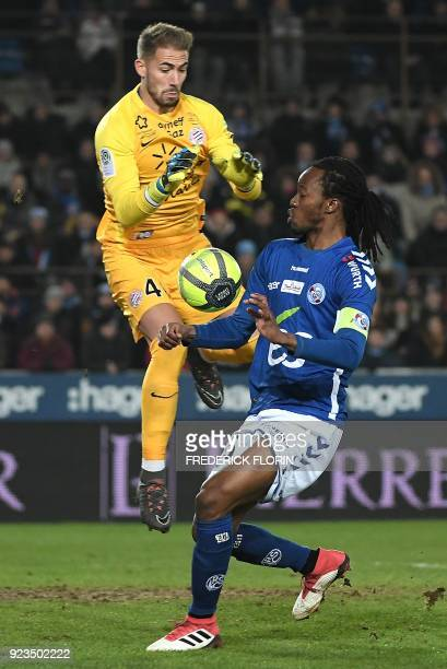 Strasbourg's Burkinabe defender Bakary Kone fights for the ball with Montpellier's French goalkeeper Benjamin Lecomte during the French L1 football...