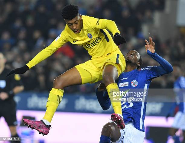 Strasbourg's Burkinabe defender Bakary Kone vies with Paris SaintGermain's French defender Presnel Kimpembe during the French L1 football match...