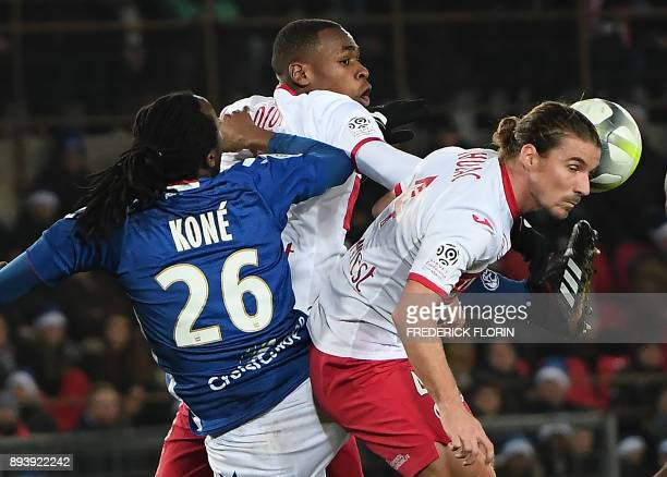 Strasbourg's Burkinabe defender Bakary Kone vies with Toulouse's French defender Issa Diop and Toulouse's French midfielder Yannick Cahuzac during...