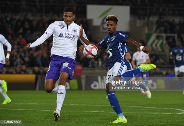 Strasbourg's Cape Verdean forward Nuno Da Costa vies with Toulouse's French defender Christopher Jullien during the French Ligue 1 football match...