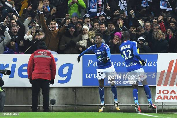 Strasbourg's Cape Verdian forward Nuno Da Costa celebrates with supporters after scoring a goal during the French L1 football match between...