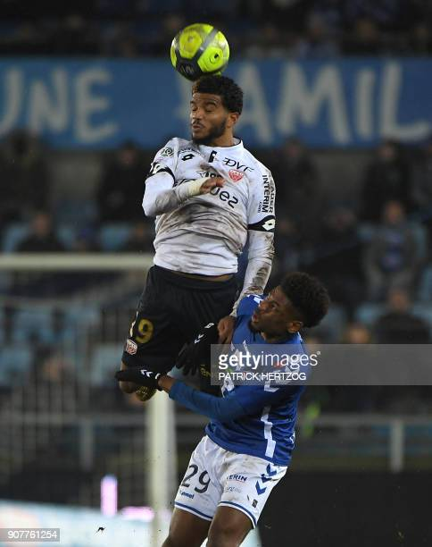 Strasbourg's Cape Verdian forward Nuno Da Costa vies with Dijon's French defender Valentin Rosier during the French Ligue 1 football match between...