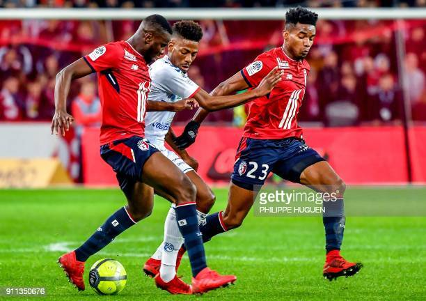 Strasbourg's Cape Verdian forward Nuno Da Costa vies with Lille's French midefielder Ibrahim Amadou and Lille's Brazilian midfielder Thiago Mendes...
