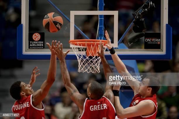 Strasbourg's forward Axel Toupane Strasbourg's Dominican Republic forward Ricardo Greer and Strasbourg's center Romain Duport jump for a basket...