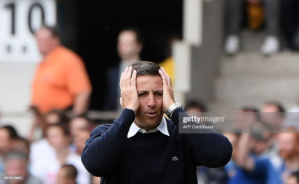 Strasbourg's French coach Thierry Laurey reacts during the French Ligue 1 football match between Strasbourg (RCSA) and Lille (LOSC) at The Meinau Stadium in Strasbourg, eastern France on August 13, 2017. /
