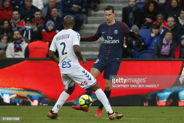 Strasbourg's French defender Dimitri Foulquier vies with Paris SaintGermain's German midfielder Julian Draxler during the French Ligue 1 football...