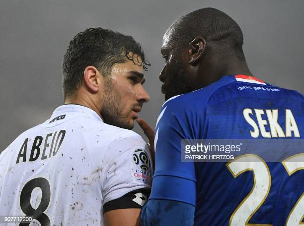 Strasbourg's French defender Ernest Seka argues with Dijon's FrenchAlgerian midfielder Mehdi Abeid during the French Ligue 1 football match between...