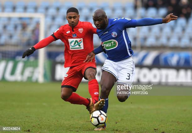 Strasbourg's French defender Ernest Seka vies with Dijon's French forward Wesley Said during the French Cup football match between Strasbourg and...