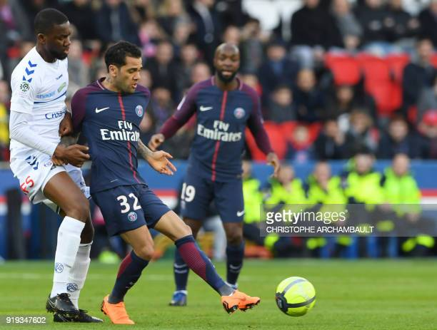 Strasbourg's French defender Ernest Seka vies with Paris SaintGermain's Brazilian defender Daniel Alves during the French Ligue 1 football match...