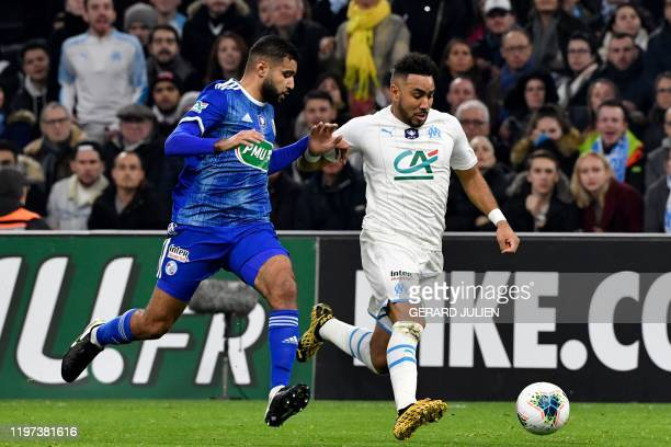 Strasbourg's French defender Ismael Aaneba vies with Marseille's French midfielder Dimitri Payet during the French Cup football match between...