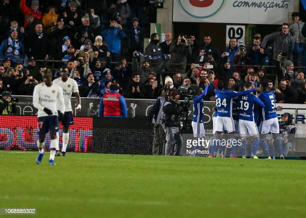 Strasbourg's French defender Kenny Lala celebrates after scores a penalty kick past Paris SaintGermain's French goalkeeper Alphonse Areola during the...