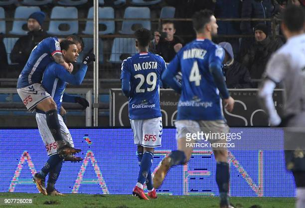 Strasbourg's French defender Kenny Lala celebrates with teammates after scoring a goal during the French Ligue 1 football match between Strasbourg...