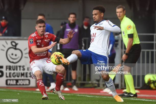 Strasbourg's French defender Kenny Lala fights for the ball with Brest's French midfielder Julien Faussurier during the French L1 Football match...
