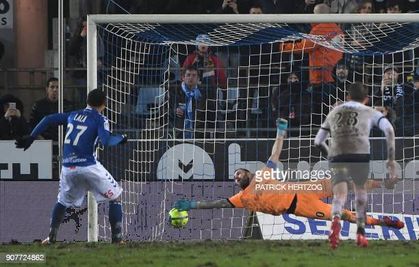Strasbourg's French defender Kenny Lala scores a goal on a penalty kick during the French Ligue 1 football match between Strasbourg and Dijon on...