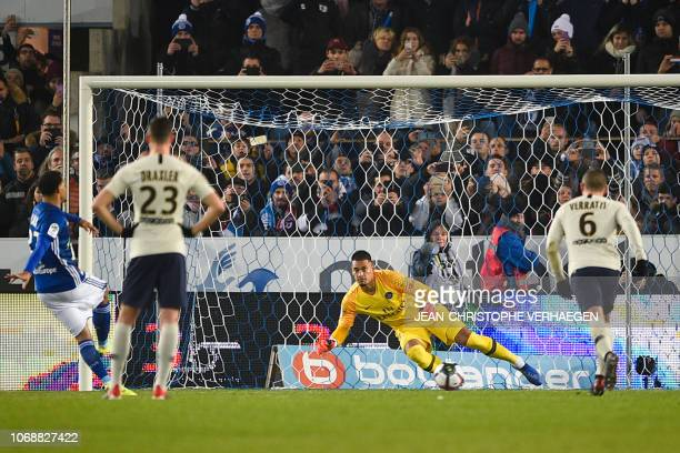 Strasbourg's French defender Kenny Lala scores a penalty kick past Paris SaintGermain's French goalkeeper Alphonse Areola during the French L1...