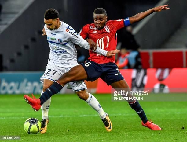 Strasbourg's French defender Kenny Lala vies with Lille's French midefielder Ibrahim Amadou during the French L1 football match between Lille and...