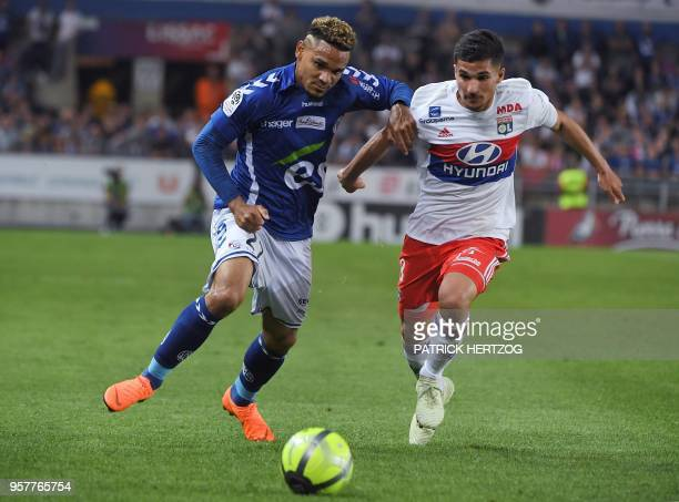 Strasbourg's French defender Kenny Lala vies with Lyon's forward Houssem Aouar during the French Ligue 1 football match between Strasbourg and Lyon...