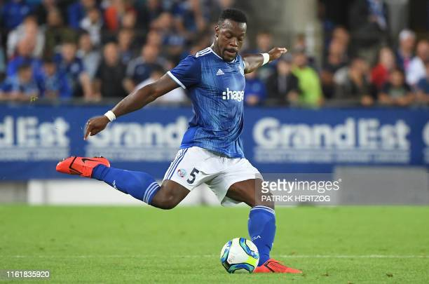 Strasbourg's French defender Lamine Kone kicks the ball during the UEFA Europa League preliminary round football match between Strasbourg and...
