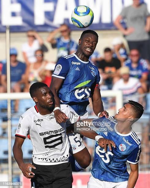 Strasbourg's French defender Lamine Kone vies with Rennes' Senegalese forward Mbaye Niang and Strasbourg's Tunisian midfielder Moataz Zemzemi during...