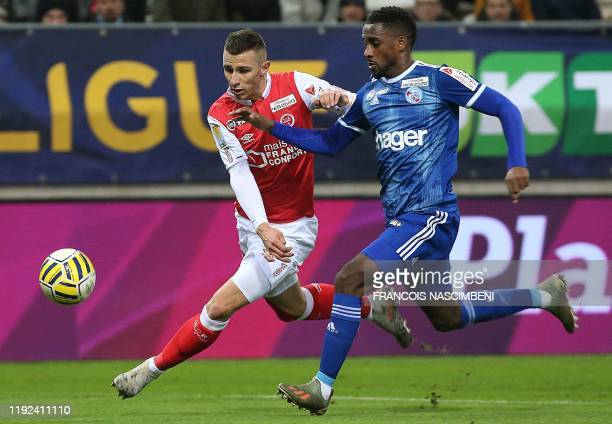 Strasbourg's French defender Lionel Carole vies with Reims' French forward Remi Oudin during the French League Cup quarterfinal football match...