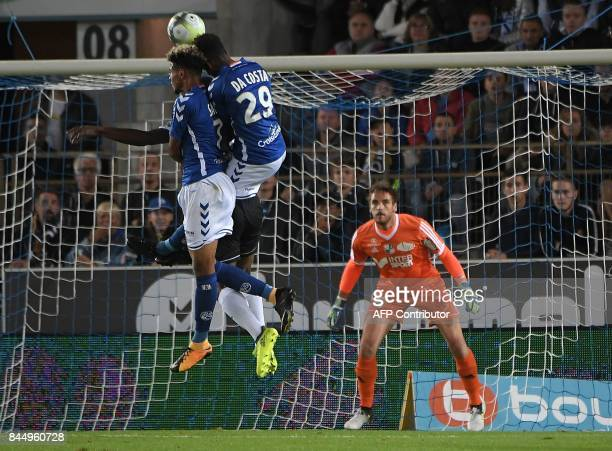 Strasbourg's French forward Ihsan Sacko and Strasbourg's Cape Verdian forward Nuno Da Costa head the ball as Amiens' French goalkeeper Regis Gurtner...