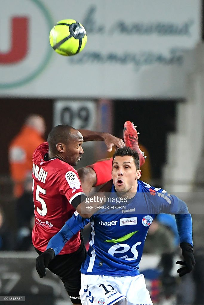 Strasbourg's French forward Jeremy Blayac (R) vies with Guingamp's French defender Jeremy Sorbon during the French L1 football match between Strasbourg (RCSA) and Guingamp (EAG) on January 12, 2018 at the Meinau stadium in Strasbourg, eastern France. /