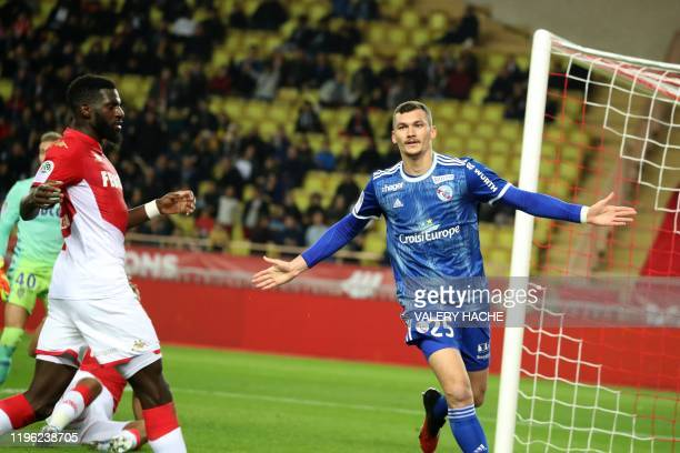 Strasbourg's French forward Ludovic Ajorque celebrates after scoring during the French L1 football match between AS Monaco vs Racing Club Strasbourg...