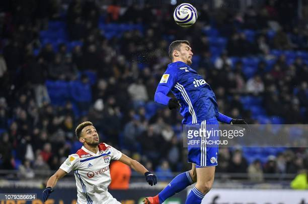 Strasbourg's French forward Ludovic Ajorque fights for the ball with Lyon's Brazilian defender Fernando Marcal during the French League Cup quarter...